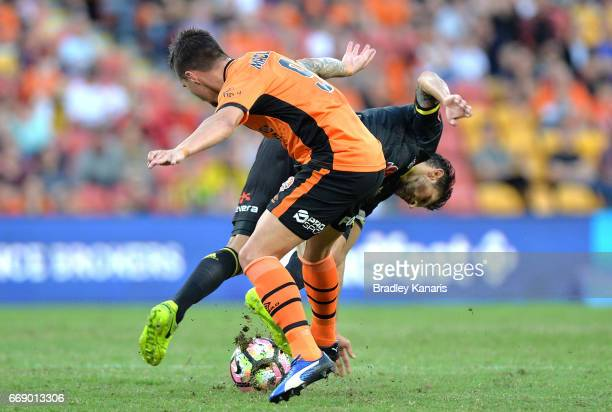 Vince Lia of the Phoenix is tackled by Jamie Maclaren of the Roar during the round 27 ALeague match between the Brisbane Roar and the Wellington...