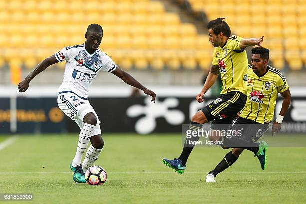 Vince Lia of the Phoenix tackles Jason Geria of Melbourne Victory during the round seven ALeague match between the Wellington Phoenix and the...