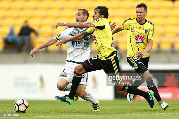 Vince Lia of the Phoenixand Carl Valeri of Melbourne Victory compete for the ball during the round seven ALeague match between the Wellington Phoenix...