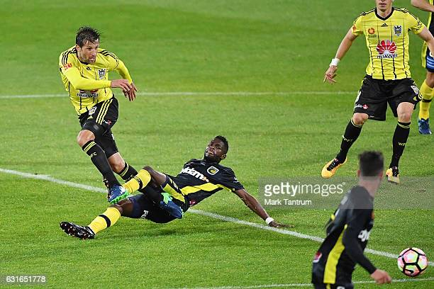 Vince Lia of the Wellington Phoenix and Kwabena Appiah of the Central Coast Mariners during the round 15 ALeague match between the Wellington Phoenix...
