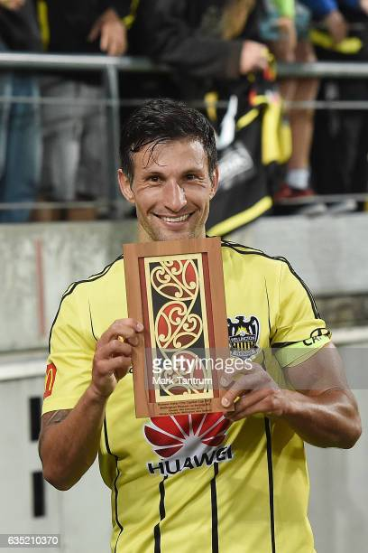 Vince Lia of the Wellington Phoenix holds the Huawei Sister City Cup after winning the round 15 ALeague match between the Wellington Phoenix and the...