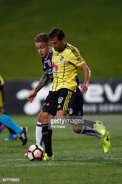 VInce Lia of Wellington takes the ball forward during the round 22 ALeague match between the Wellington Phoenix and the Perth Glory at QBE Stadium on...