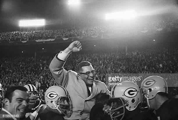 Vince Lombardi being carried by Green Bay Packers players after defeating the Dallas Cowboys
