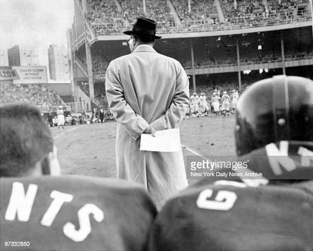 Vince Lombardi of the New York Giants' clutches a play chart during a game at Yankee Stadium