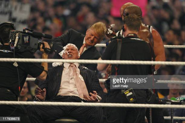 Vince McMahon gets his head shaved by Stone Cold Steve Austin after as Donald Trump looks on at WrestleMania 23 at Detroit's Ford Field Detroit...