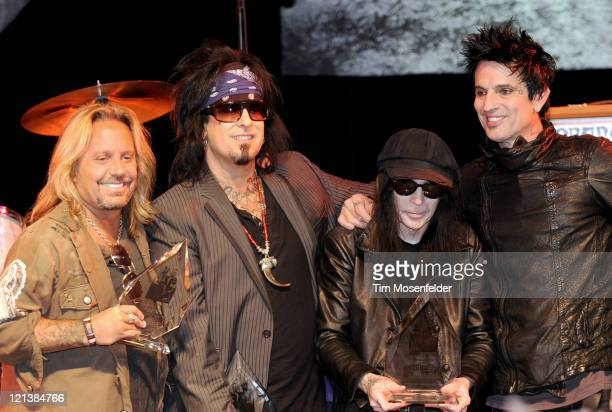Vince Neil Nikki Sixx Mick Mars and Tommy Lee of Motley Crue receive an award at the Annual Sunset Strip Music Festival Tribute to Motley Crue at the...