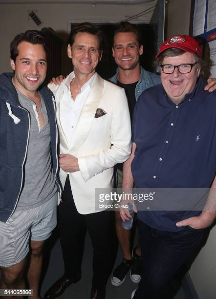 Vince Oddo Jim Carrey Nicholas Cunningham and Michael Moore pose as Carrey guest stars and makes his broadway debut in 'Michael Moore's play 'The...