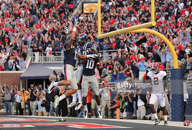 Vince Sanders of the Ole Miss Rebels celebrates his touchdown catch with Evan Engram of the Ole Miss Rebels against the Alabama Crimson Tide on...