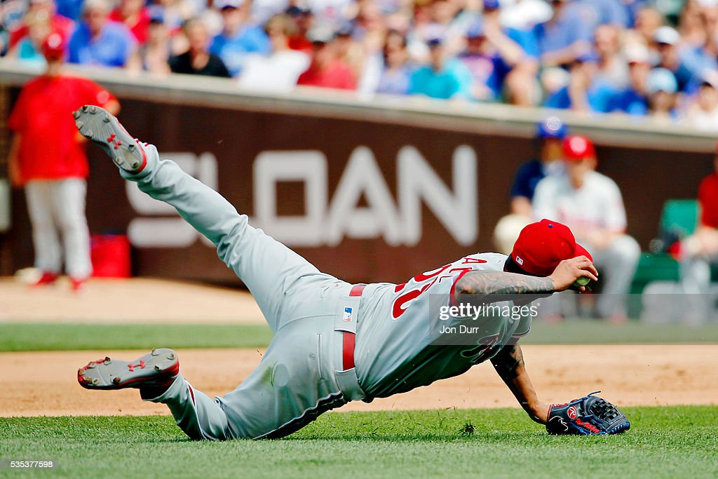 Vince Velasquez #28 of the Philadelphia Phillies throws to second base while on the ground during the sixth inning against the Chicago Cubs at Wrigley Field on May 29, 2016 in Chicago, Illinois.