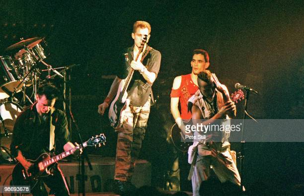 Vince White Paul Simonon Nick Sheppard and Joe Strummer of The Clash perform on stage at the Brixton Academy on March 8th 1984 in London England