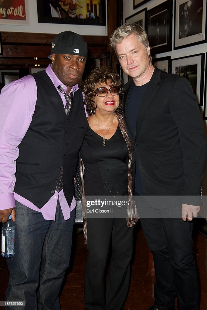 Vince Wilburn Jr. (nephew of Miles Davis), Frances Taylor (ex-wife of Miles Davis) and Trumpeter Chris Botti attend the 'Miles Davis: The Collected Artwork' Launch Party at Mr. Musichead Gallery on November 7, 2013 in Los Angeles, California.