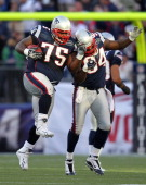 Vince Wilfork of the New England Patriots celebrates his interception and run with teammate Deion Branch of the New England Patriots in the first...
