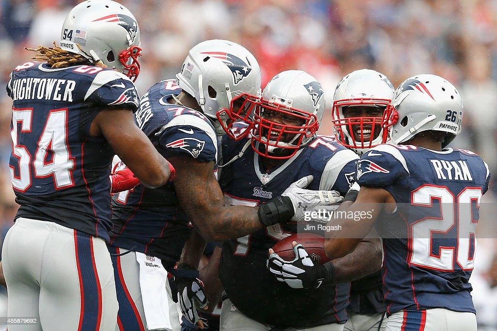 <a gi-track='captionPersonalityLinkClicked' href=/galleries/search?phrase=Vince+Wilfork&family=editorial&specificpeople=226996 ng-click='$event.stopPropagation()'>Vince Wilfork</a> #75 of the New England Patriots celebrates with teammates after intercepting the ball during the fourth quarter against Oakland Raiders at Gillette Stadium on September 21, 2014 in Foxboro, Massachusetts.