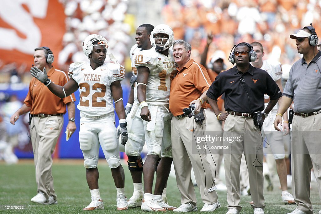 Vince Young #10 and head coach Mack Brown are all smiles as the Texas Longhorns defeated the Colorado Buffalos 70-3 in the Big 12 Championship at Reliant Stadium in Houston, Texas on December 3, 2005.