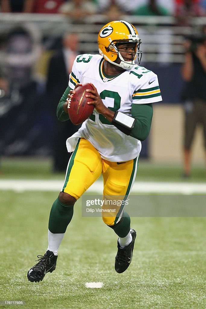 <a gi-track='captionPersonalityLinkClicked' href=/galleries/search?phrase=Vince+Young&family=editorial&specificpeople=179485 ng-click='$event.stopPropagation()'>Vince Young</a> #13 of the Green Bay Packers looks to pass the ball during a preseason game against the St. Louis Rams at the Edward Jones Dome on August 17, 2013 in St. Louis, Missouri.