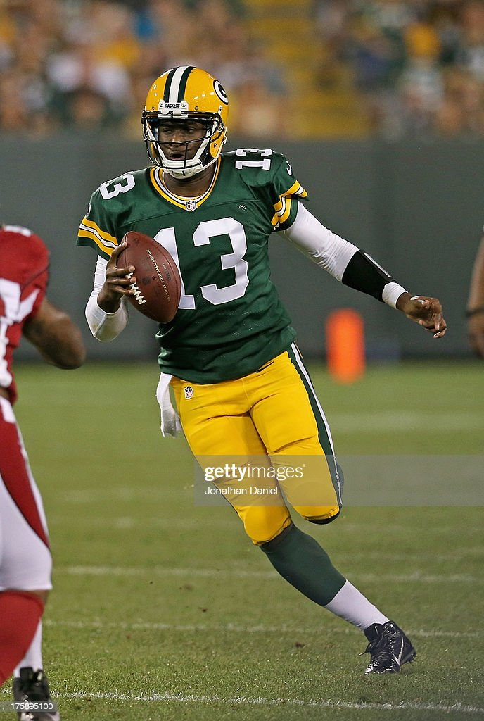 <a gi-track='captionPersonalityLinkClicked' href=/galleries/search?phrase=Vince+Young&family=editorial&specificpeople=179485 ng-click='$event.stopPropagation()'>Vince Young</a> #13 of the Green Bay Packers runs for a first down against the Arizona Cardinals at Lambeau Field on August 9, 2013 in Green Bay, Wisconsin.