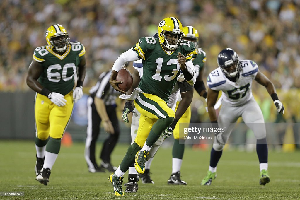 <a gi-track='captionPersonalityLinkClicked' href=/galleries/search?phrase=Vince+Young&family=editorial&specificpeople=179485 ng-click='$event.stopPropagation()'>Vince Young</a> #13 of the Green Bay Packers runs the ball upfield for a Packers first down during the game against the Seattle Seahawks at Lambeau Field on August 23, 2013 in Green Bay, Wisconsin.
