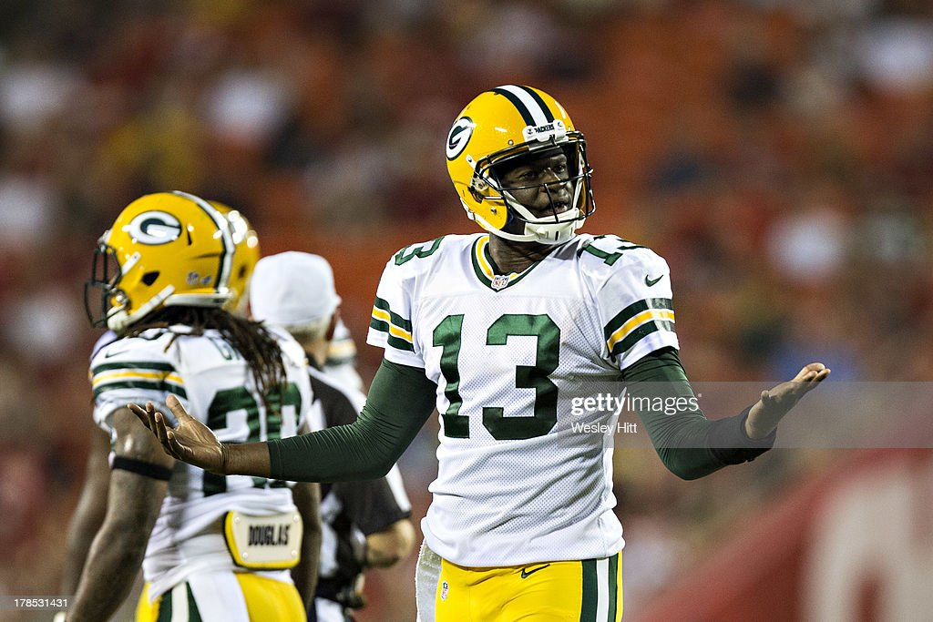 <a gi-track='captionPersonalityLinkClicked' href=/galleries/search?phrase=Vince+Young&family=editorial&specificpeople=179485 ng-click='$event.stopPropagation()'>Vince Young</a> #13 of the Green Bay Packers signals to a teammate after a missed pass against the Kansas City Chiefs during the last preseason game at Arrowhead Stadium on August 29, 2013 in Kansas CIty, Missouri.