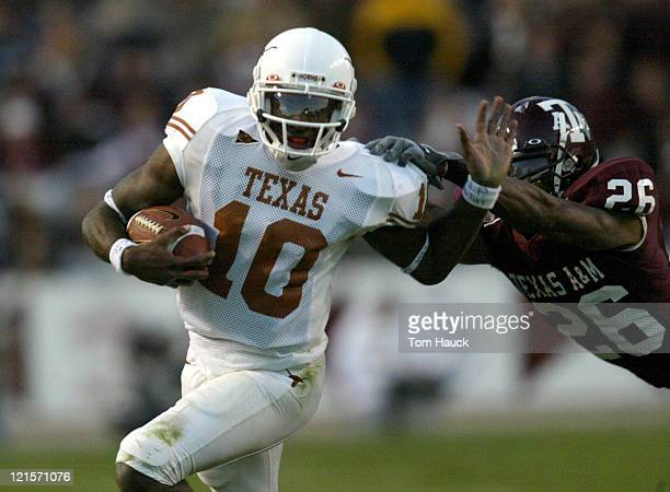 Vince Young of the Texas Longhorns runs with the ball The Texas Longhorns defeat the Texas AM Aggies 4615 at Kyle Field in College Station Texas