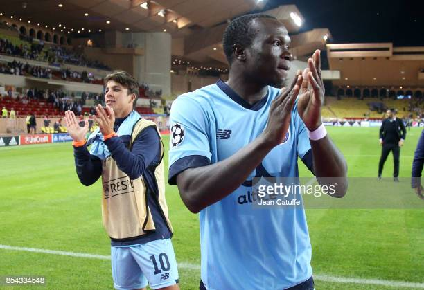 Vincent Aboubakar and Oliver Torres of FC Porto celebrate the victory following the UEFA Champions League group G match between AS Monaco and FC...