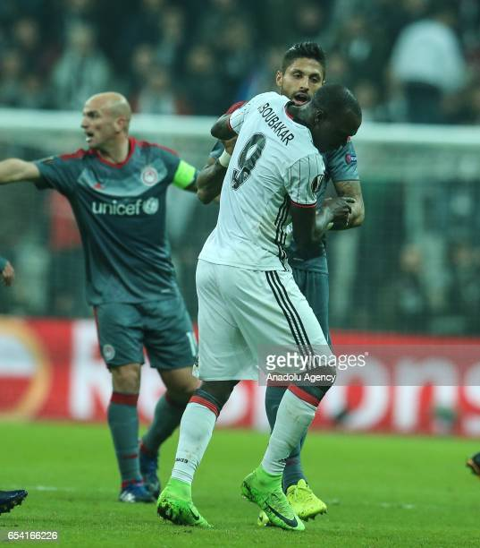 Vincent Aboubakar of Besiktas argues with Manuel De Costa of Olympiacos during the UEFA Europa League Round 16 secondleg match between Besiktas and...