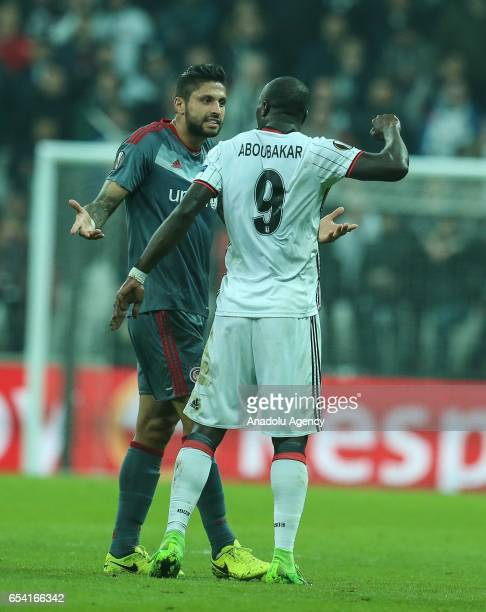 Vincent Aboubakar of Besiktas argues with with Manuel De Costa of Olympiacos during the UEFA Europa League Round 16 secondleg match between Besiktas...