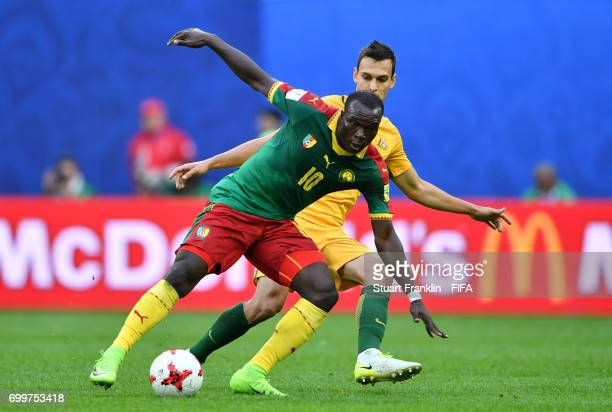Vincent Aboubakar of Cameroon attempts to take the ball past Trent Sainsbury of Australia during the FIFA Confederations Cup Russia 2017 Group B...