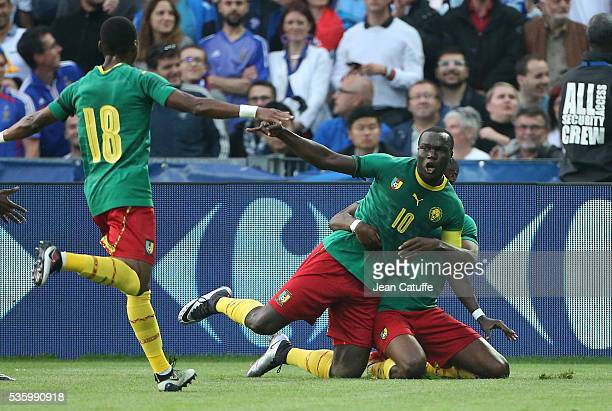 Vincent Aboubakar of Cameroon celebrates his goal with teammates during the international friendly match between France and Cameroon at Stade de La...