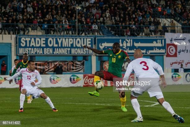 Vincent Aboubakar of Cameroon in action against Ali Maaloul and Aymen Abdennour during the friendly football match between Tunisia and Cameroon at...