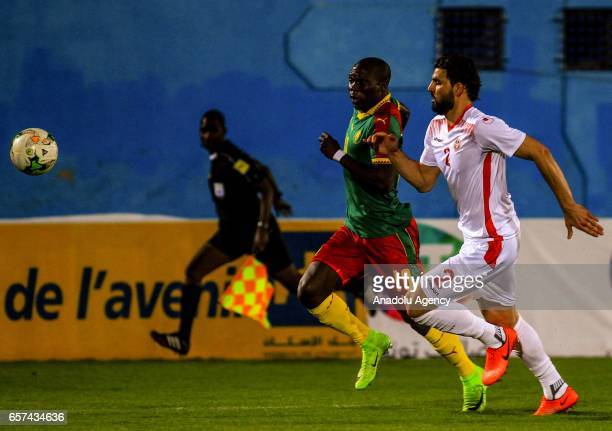 Vincent Aboubakar of Cameroon in action against Syam Ben Youssef of Tunisia during the friendly football match betweenTunisia and Cameroon at the Ben...
