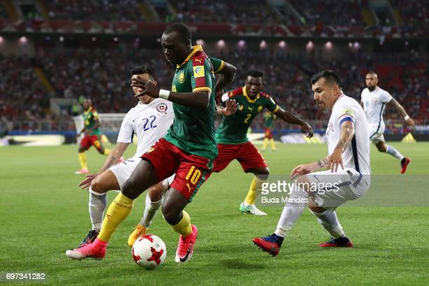 Vincent Aboubakar of Cameroon is put under pressure from Edson Puch of Chile during the FIFA Confederations Cup Russia 2017 Group B match between...