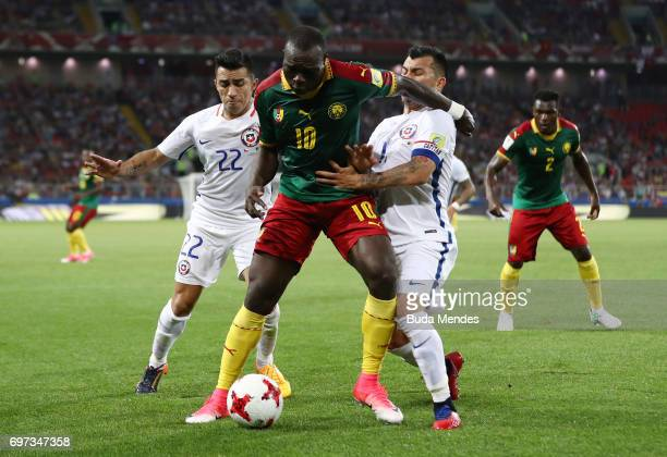 Vincent Aboubakar of Cameroon is put under pressure from Edson Puch of Chile and Gary Medel of Chile during the FIFA Confederations Cup Russia 2017...