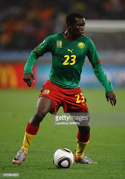 Vincent Aboubakar of Cameroon runs with the ball during the 2010 FIFA World Cup South Africa Group E match between Cameroon and Netherlands at Green...