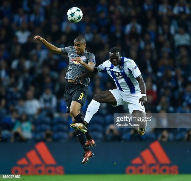 Vincent Aboubakar of FC Porto competes for the ball with Bernardo Junior of RB Leipzig during the UEFA Champions League group G match between FC...
