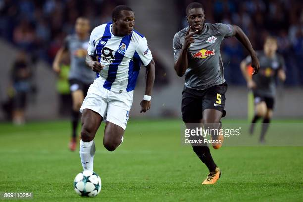 Vincent Aboubakar of FC Porto competes for the ball with Dayot Upamecano of RB Leipzig during the UEFA Champions League group G match between FC...