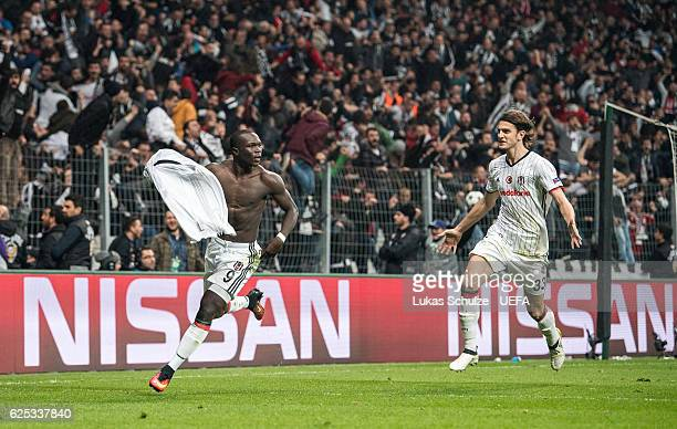 Vincent Aboubakar of Istanbul celebrates his teams third goal with Atinc Nukan during the UEFA Champions League match between Besiktas JK and SL...