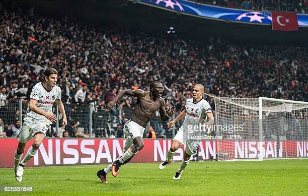 Vincent Aboubakar of Istanbul celebrates his teams third goal with Atinc Nukan and Gokhan Inler during the UEFA Champions League match between...
