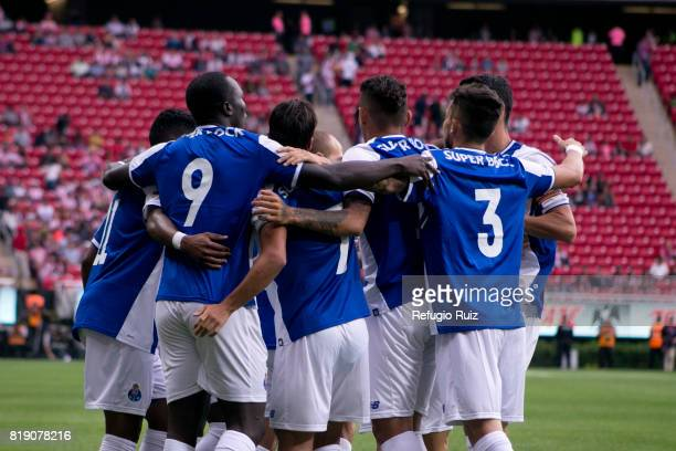 Vincent Aboubakar of Porto celebrates with his teammates after scoring the firts goal of his team during a the friendly match between Chivas and...