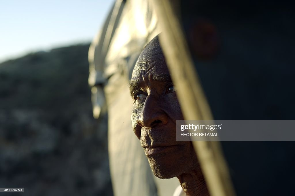 Vincent Adelson looks out from his home on a hill in Canaan outside of Port au Prince on January 2 where he lives alone Canaan is a settlement to the...