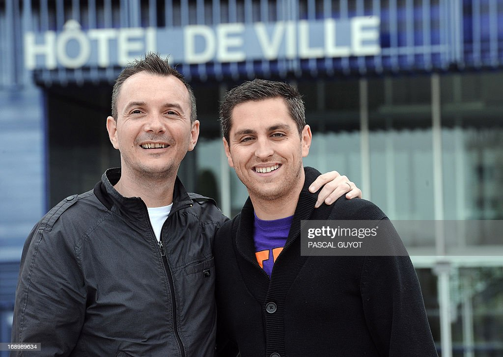 Vincent Autin (L) and his partner Bruno Boileau pose for a photograph on May 18, 2013 in front of the city hall of Montpellier, southern France. The socialist mayor of Montpellier, Helene Mandroux, will celebrate on May 29, 2013 at the city hall of Montpellier the first French homosexual marriage with the wedding uniting Vincent Autin and his partner Bruno. Montpellier is known as being the 'French San Francisco' and was elected by the French gay magazine Tetu on December 2012 as being the 'most friendly' French town. After months of acrimonious debate and hundreds of protests that have occasionally spilled over into violence, France's National Assembly approved on April 23, 2013 a bill making the country the 14th to legalise same-sex marriage. AFP PHOTO / PASCAL GUYOT