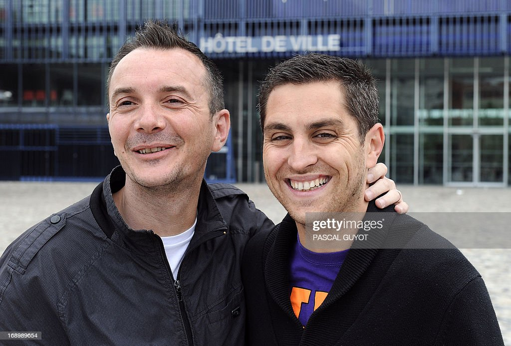 Vincent Autin (L) and his partner Bruno pose for a photograph on May 18, 2013 in front of the city hall of Montpellier, southern France. The socialist mayor of Montpellier, Helene Mandroux, will celebrate on May 29, 2013 at the city hall of Montpellier the first French homosexual marriage with the wedding uniting Vincent Autin and his partner Bruno. Montpellier is known as being the 'French San Francisco' and was elected by the French gay magazine Tetu on December 2012 as being the 'most friendly' French town. After months of acrimonious debate and hundreds of protests that have occasionally spilled over into violence, France's National Assembly approved on April 23, 2013 a bill making the country the 14th to legalise same-sex marriage.