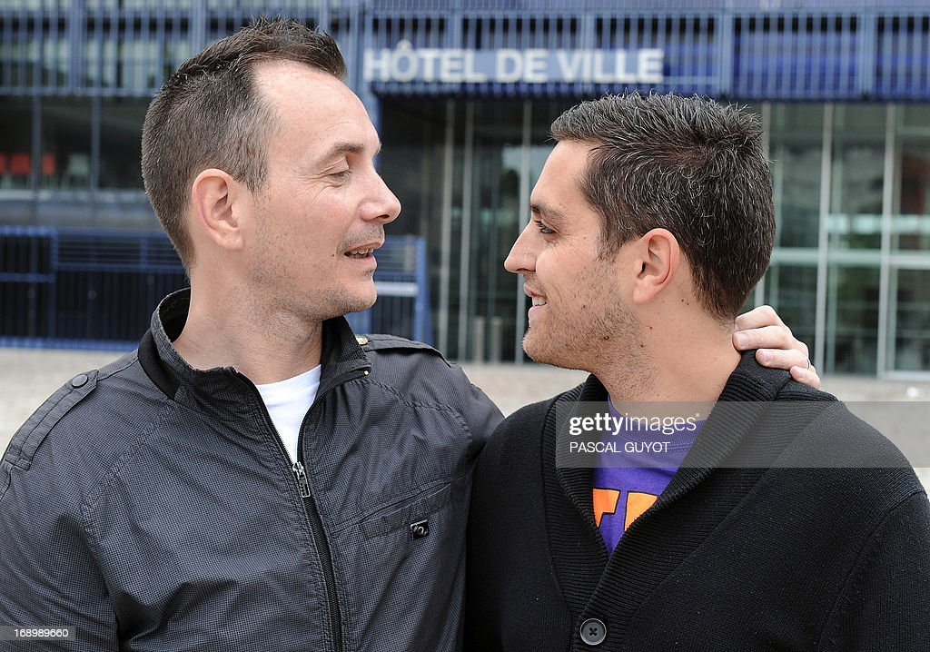 Vincent Autin (L) and his partner Bruno pose for a photograph on May 18, 2013 in front of the city hall of Montpellier, southern France. The socialist mayor of Montpellier, Helene Mandroux, will celebrate on May 29, 2013 at the city hall of Montpellier the first French homosexual marriage with the wedding uniting Vincent Autin and his partner Bruno. Montpellier is known as being the 'French San Francisco' and was elected by the French gay magazine Tetu on December 2012 as being the 'most friendly' French town. After months of acrimonious debate and hundreds of protests that have occasionally spilled over into violence, France's National Assembly approved on April 23, 2013 a bill making the country the 14th to legalise same-sex marriage. AFP PHOTO / PASCAL GUYOT