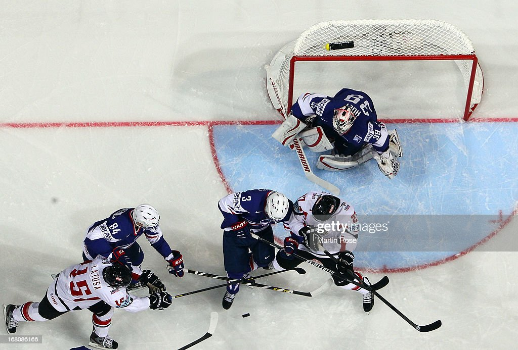 Vincent Bachet (#3) of France and Thomas Hundertpfund (#27) of Austria battle for the puck during the IIHF World Championship group H match between France and Austria at Hartwall Areena on May 5, 2013 in Helsinki, Finland.
