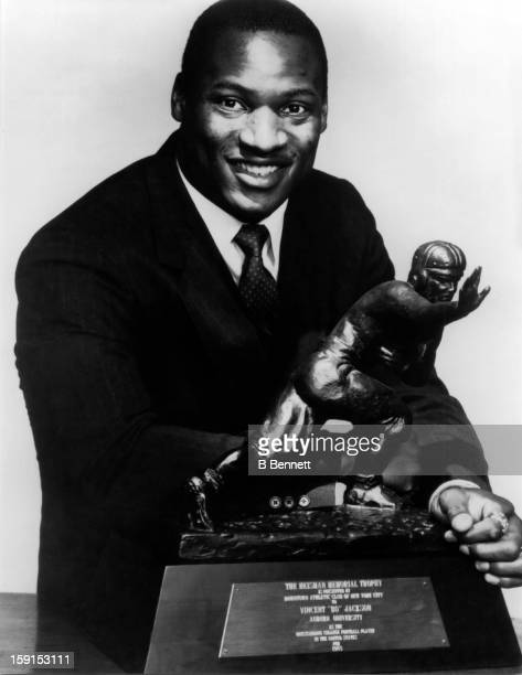 Vincent 'Bo' Jackson of the Auburn Tigers poses with the Heisman Trophy after winning it on December 12 1985 in New York New York