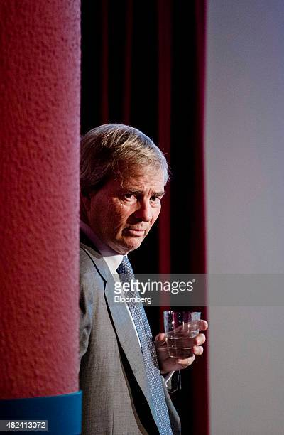 Vincent Bollore billionaire and chairman of the Bollore Group looks on during an Autolib carsharing scheme news conference in Paris France on...
