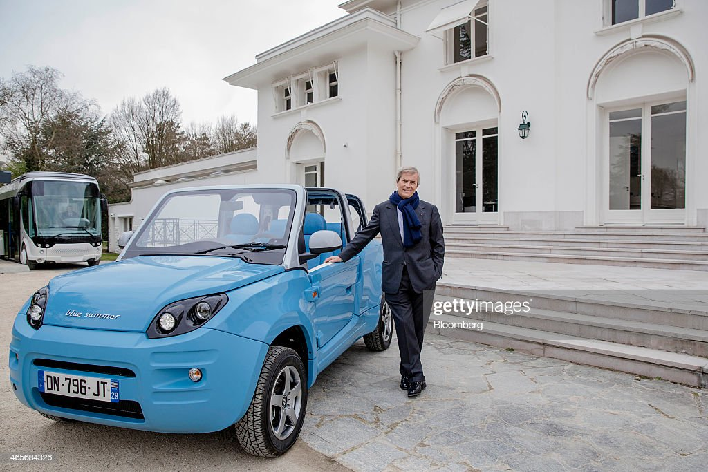 Vincent Bollore, billionaire and chairman of the Bollore Group, poses with a Blue Summer car at the Autolib' car-sharing headquarters in Vaucresson, France, on Monday, March 9, 2015. Bollore is targeting Los Angeles and Singapore as the next markets for his Autolib' electric-car sharing service after its debuts later this year in London and Indianapolis. Photographer: Marlene Awaad/Bloomberg via Getty Images