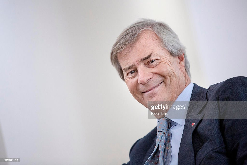 Vincent Bollore, billionaire and chairman of the Bollore Group, reacts during an interview at the Autolib' car-sharing headquarters in Vaucresson, France, on Monday, March 9, 2015. Bollore is targeting Los Angeles and Singapore as the next markets for his Autolib' electric-car sharing service after its debuts later this year in London and Indianapolis. Photographer: Marlene Awaad/Bloomberg via Getty Images