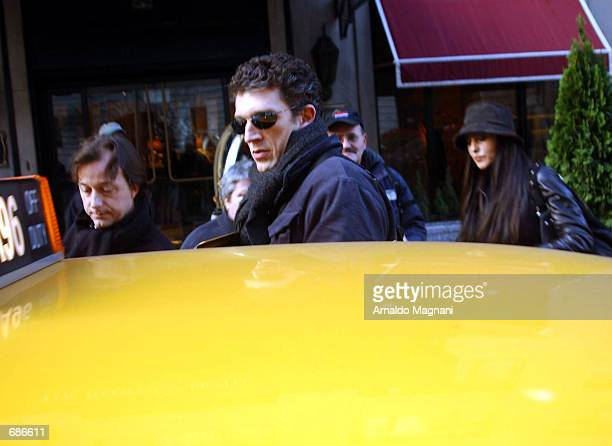 Vincent Cassel and his wife Monica Bellucci get into a cab December 10 2001 in New York City Bellucci is in New York to promote her new movie...