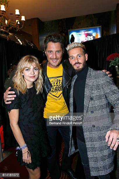 Vincent Cerutti standing between French voices of the movie Louane Emera and Matt Pokora attend 'Les Trolls' Paris Premiere at Le Grand Rex on...
