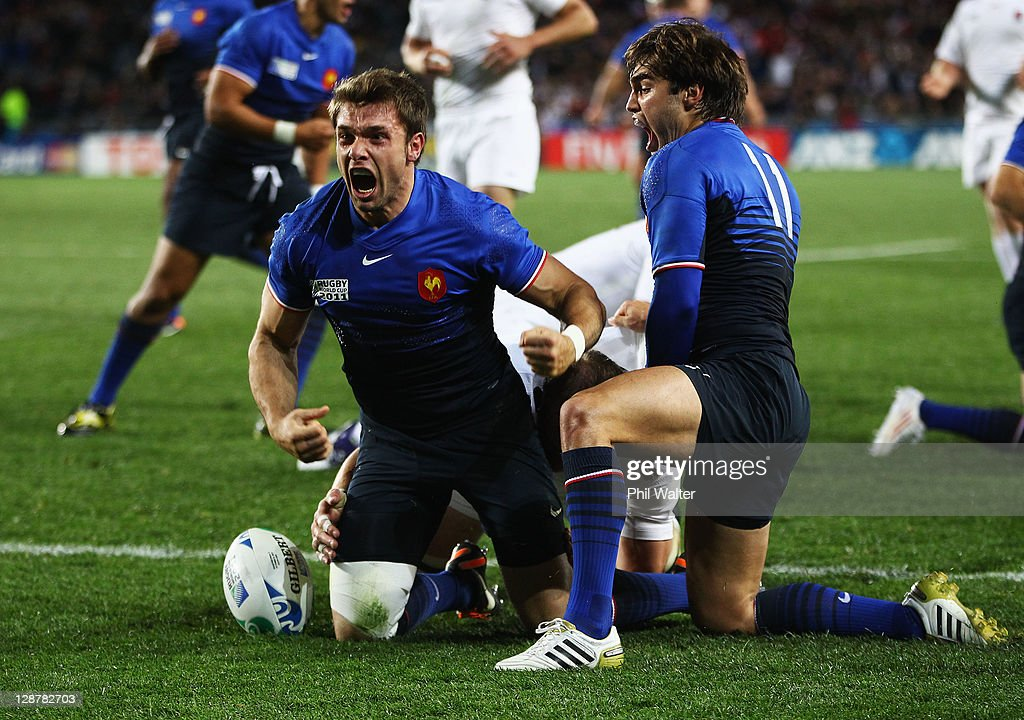 <a gi-track='captionPersonalityLinkClicked' href=/galleries/search?phrase=Vincent+Clerc&family=editorial&specificpeople=235795 ng-click='$event.stopPropagation()'>Vincent Clerc</a> of France celebrates his opening try with <a gi-track='captionPersonalityLinkClicked' href=/galleries/search?phrase=Alexis+Palisson&family=editorial&specificpeople=5365066 ng-click='$event.stopPropagation()'>Alexis Palisson</a> (R) during quarter final two of the 2011 IRB Rugby World Cup between England and France at Eden Park on October 8, 2011 in Auckland, New Zealand.